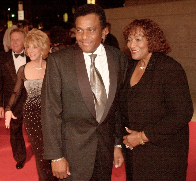 FILE - In this Oct. 26, 2000, file photo, Country music legend Charley Pride with his wife Rozene arrive at the Gaylord Entertainment Center to celebrate, Garth Brooks' selling 100 million albums, during a private party in his honor in Nashville, Tenn.