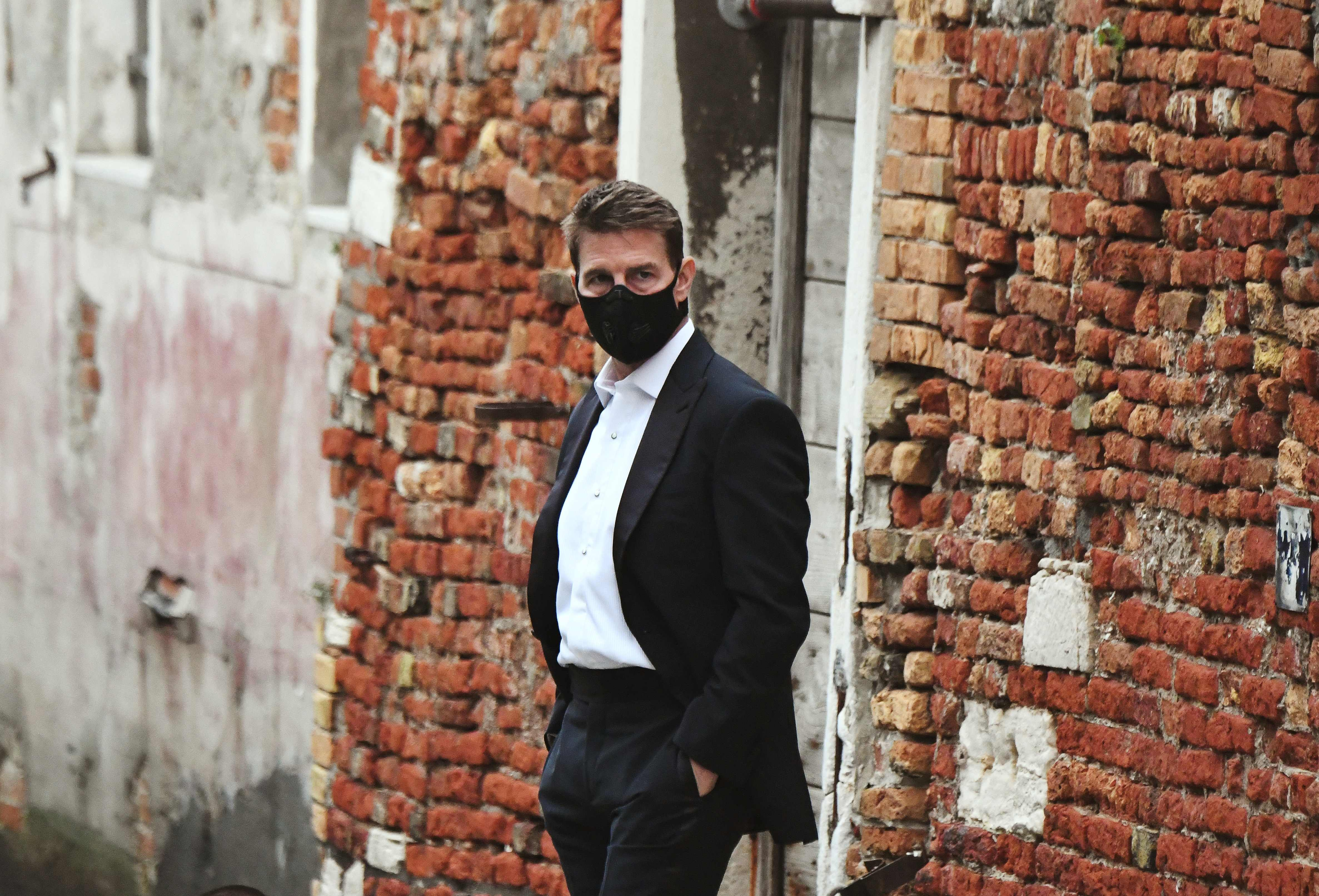 "Tom Cruise wears a mask on the set of ""Mission: Impossible 7"" in Venice."