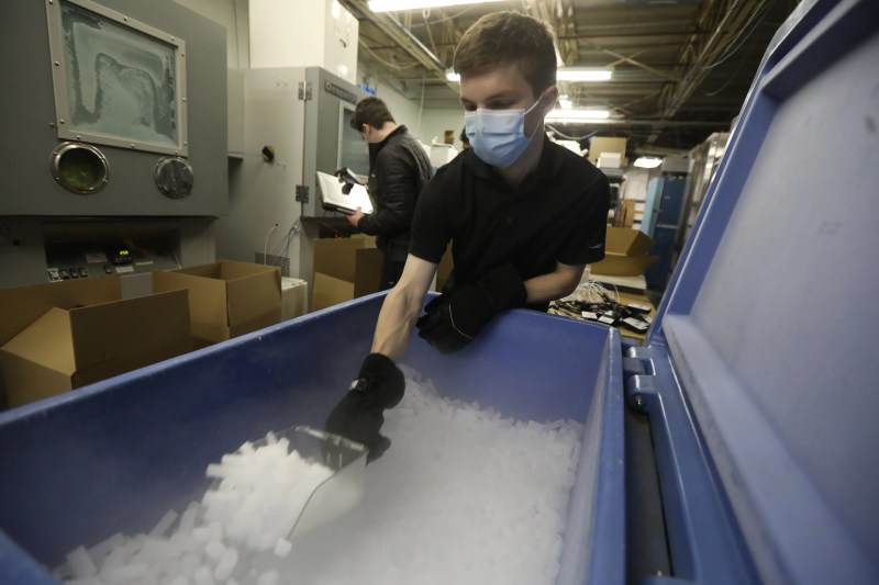 AeroSafe Global works with biopharma companies on packing and help ship their products.  The only non biopharma business they do is with NASA.  Lately they have been focused on shipping the COVID-19 vaccine working on making different storage and delivery packaging for their clients which also include pharmacies.  Andrew Spencer, a medical packaging intern from RIT, scoops ice from a container to fill a box for shipping.