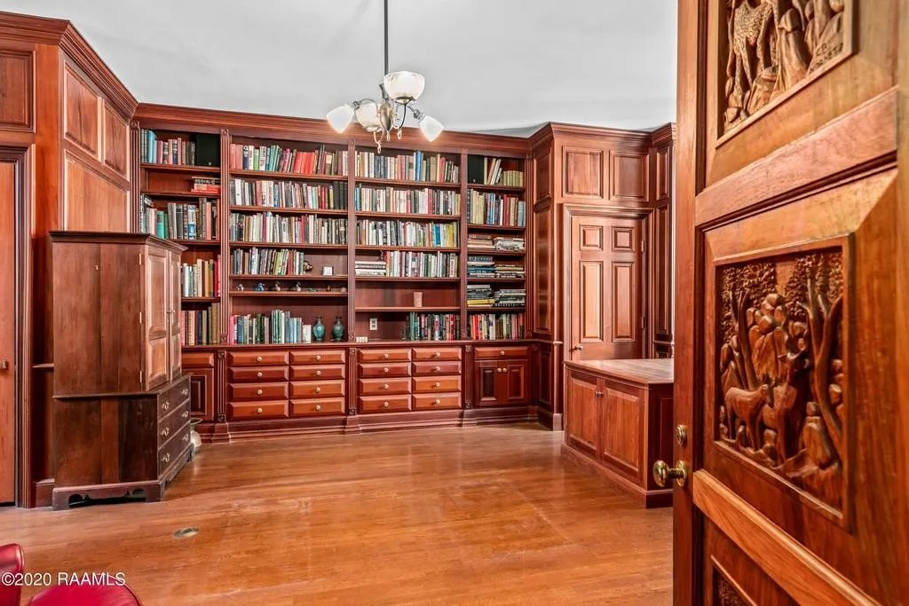 Wooded top to bottom, with carvings in the doors, the office also acts as a library.   Originally built in 1935, this Abbeville mansion is anything but your average historical Acadian mansion with an elevator, sauna,cabana, rose garden andwell on the property.