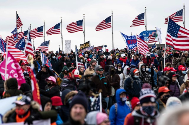 An Oath Keepers banner in a stylized version of an Army Ranger insignia is seen among the flags of thousands of Trump supporters gathered on the National Mall to hear Donald Trump speak against the 2020 election results just hours before protesters stormed the Capitol Building during Congress meeting to certify electoral votes confirming Joe Biden as president on Jan. 6, 2021.
