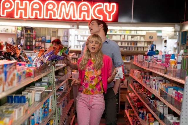 "Cassie (Carey Mulligan) and Ryan (Bo Burnham) bond over a Paris Hilton song in a pharmacy in ""Promising Young Woman."""