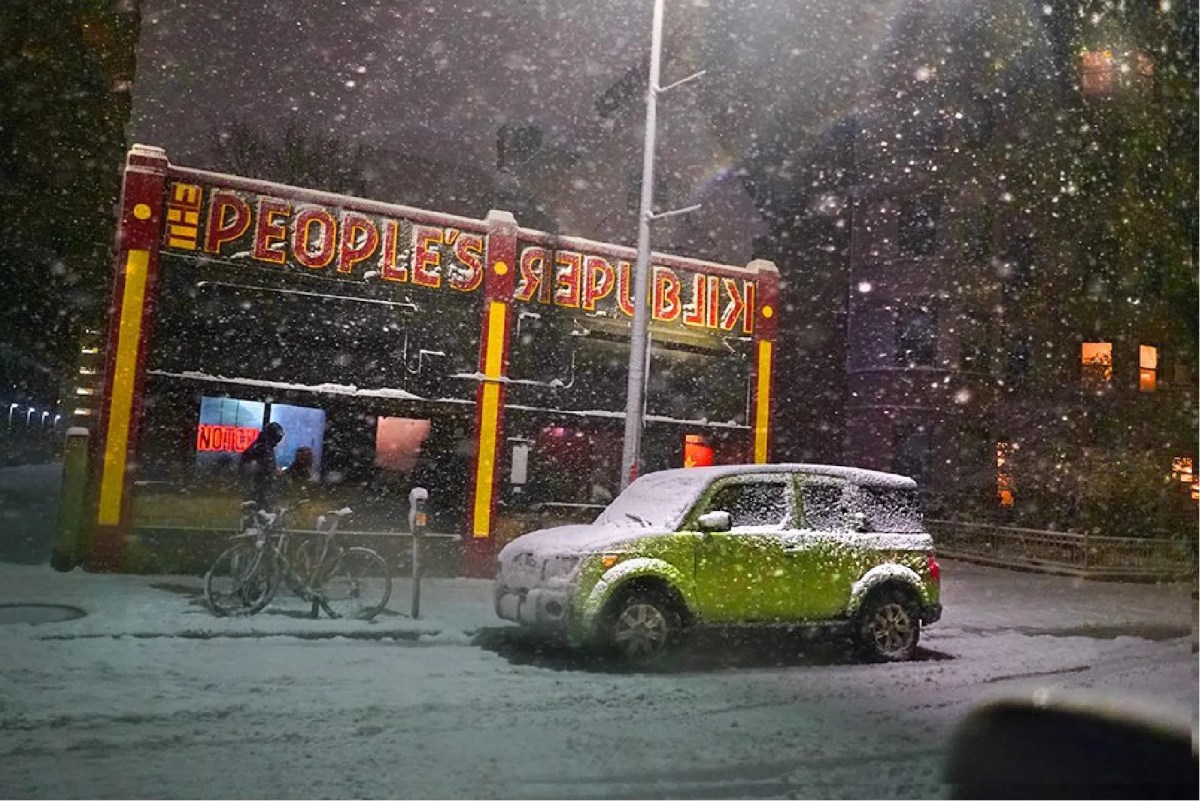 """Karl Baden's """"People's Republik in Snowstorm,"""" one of the five winning artworks of the Vacant Storefront Creative Contest in Cambridge in 2019."""