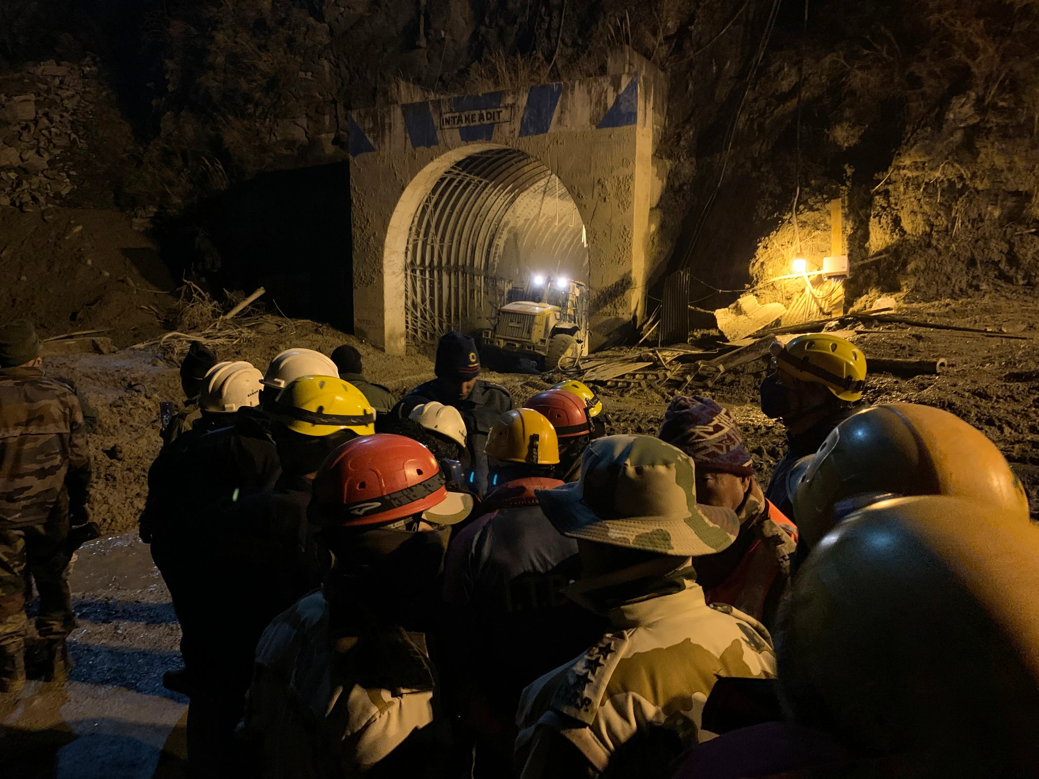 Indo Tibetan Border Police use heavy machinery on Feb. 8, 2021, to clear debris as they try to rescue more than three dozen power plant workers trapped in a tunnel after part of a Himalayan glacier broke off Feb. 7, 2021, and sent a wall of water and debris rushing down the mountain in Tapovan area of the northern state of Uttarakhand, India.