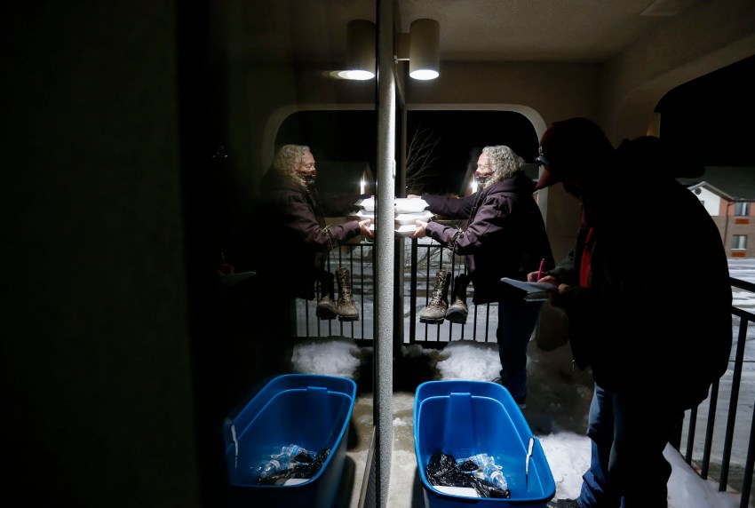 Vicki Walden and her husband Lane deliver meals to hotel rooms that The Connecting Grounds has put residents in to escape the cold weather on Tuesday, Feb. 16, 2021.