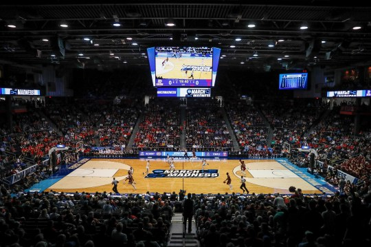 Spectators watch from the stands during a First Four game between Temple and Belmont at the 2019 NCAA men's basketball tournament, in Dayton, Ohio.