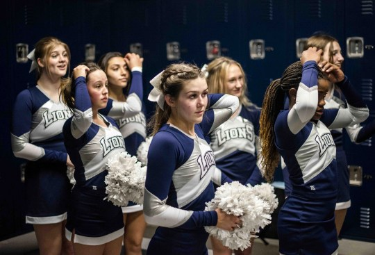 Feb. 27, 2021; Anthem, AZ, USA; North Valley Christian Academy's women's basketball and cheer team adjust their hair before having their photo taken at North Valley Christian Academy on Feb. 27, 2021. Credit: Meg Potter/The Arizona Republic