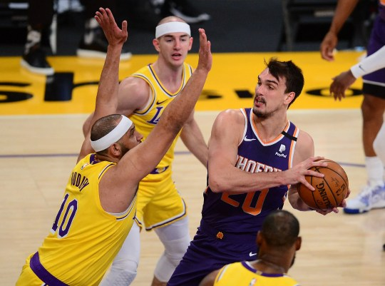 Mar 2, 2021; Los Angeles, California, USA; Phoenix Suns forward Dario Saric (20) moves to the basket against Los Angeles Lakers forward Jared Dudley (10) during the first half at Staples Center. Mandatory Credit: Gary A. Vasquez-USA TODAY Sports