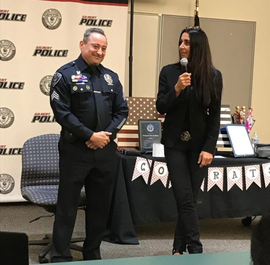 Gilbert police Officer David Bush stands with his wife, Eva DeCozio-Bush, at his retirement ceremony on Feb. 25, 2021, after serving in the Gilbert Police Department for 33 years.
