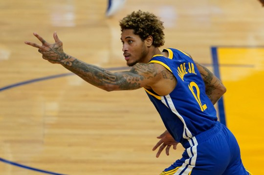 Golden State Warriors guard Kelly Oubre Jr. gestures against the Cleveland Cavaliers during an NBA basketball game in San Francisco, Monday, Feb. 15, 2021. (AP Photo/Jeff Chiu).