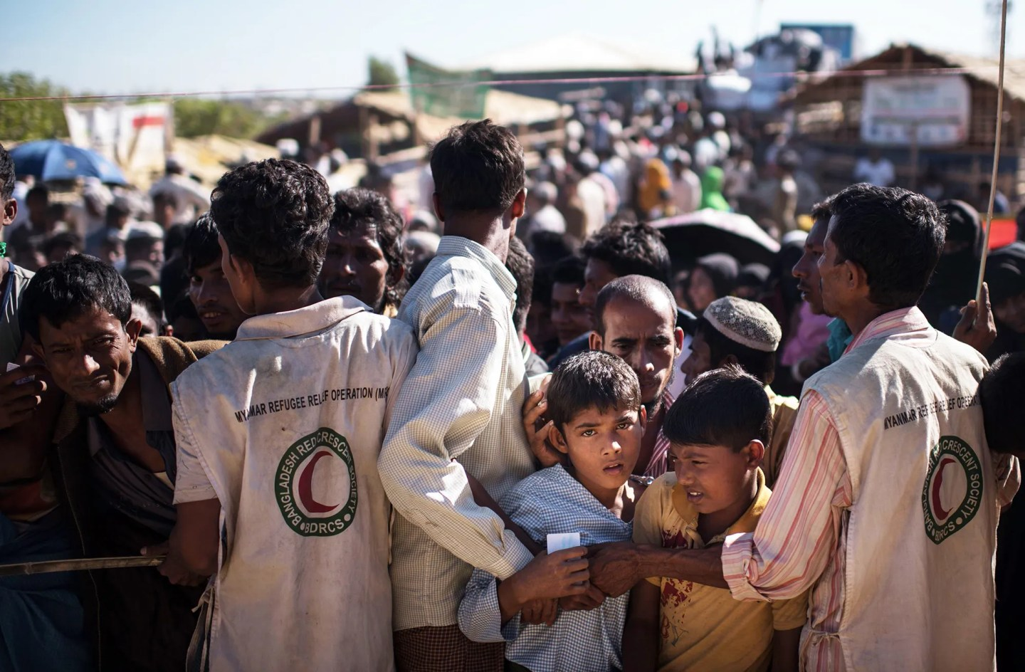 Rohingya Muslim refugee children queue for aid supplies at the Kutupalong refugee camp in Cox's Bazaar in Bangladesh on Dec. 4, 2017.