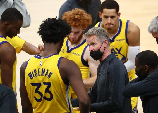 Mar 4, 2021; Phoenix, Arizona, USA; Golden State Warriors head coach Steve Kerr (right) talks with center James Wiseman (33) in the huddle against the Phoenix Suns in the second half at Phoenix Suns Arena. Mandatory Credit: Mark J. Rebilas-USA TODAY Sports