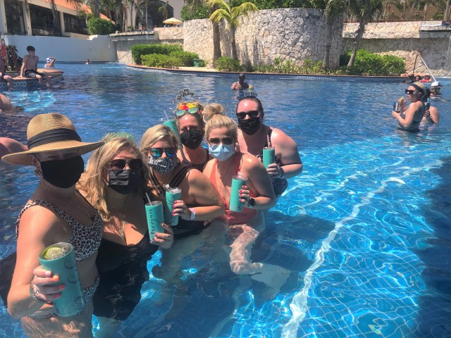 A group of friends from the Midwest flew to Cancun to celebrate the 40th birthday of Harmony Godsey, who sported a flowery birthday tiara, third from right.