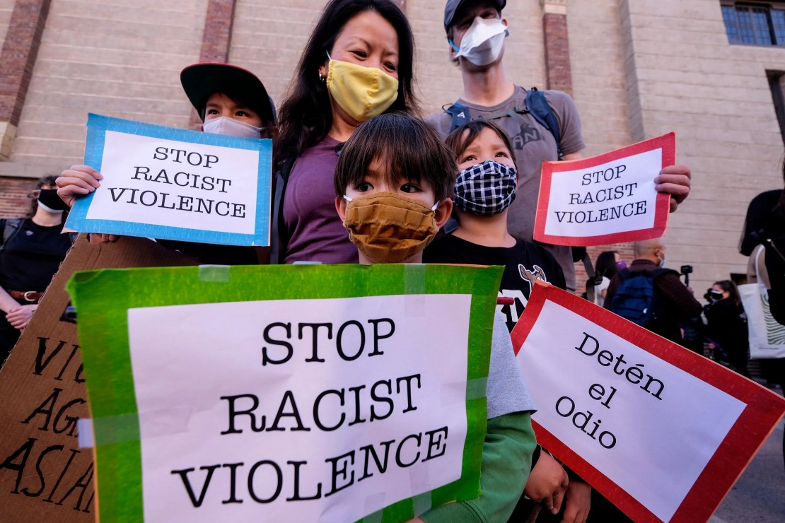 A family takes part in a rally to raise awareness of anti-Asian violence, at the Japanese American National Museum in Little Tokyo in Los Angeles, California, on March 13, 2021.