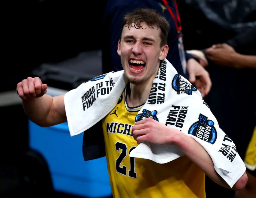 Michigan Wolverines guard Franz Wagner (21) celebrates after defeating Florida State during the Sweet Sixteen round of the 2021 NCAA tournament on Sunday, March 28, 2021, at Bankers Life Fieldhouse in Indianapolis, Ind.