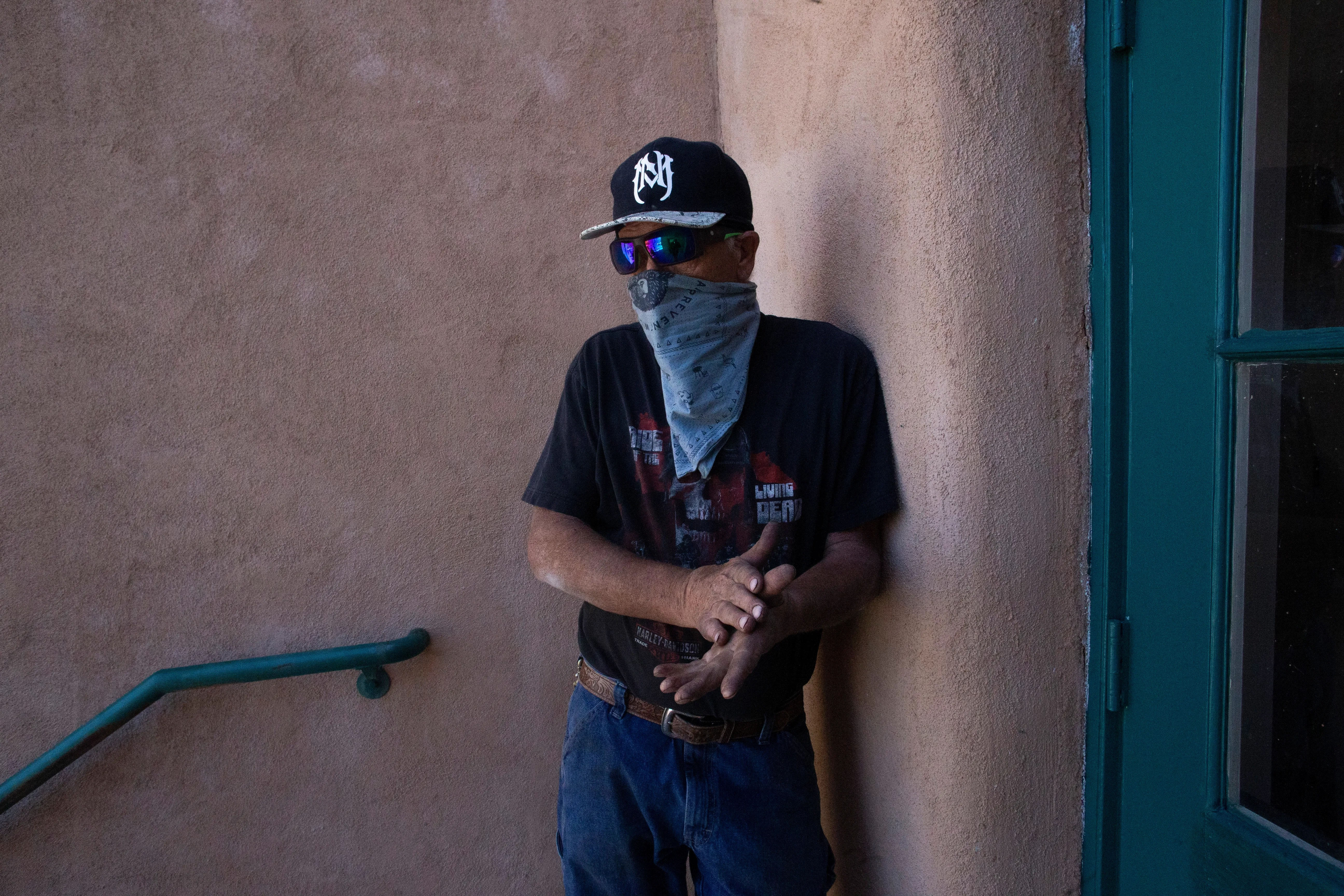 Timothy Dusharm begins to feel nervous as is the next in line to get the COVID-19 vaccination in Hillsboro, N.M.
