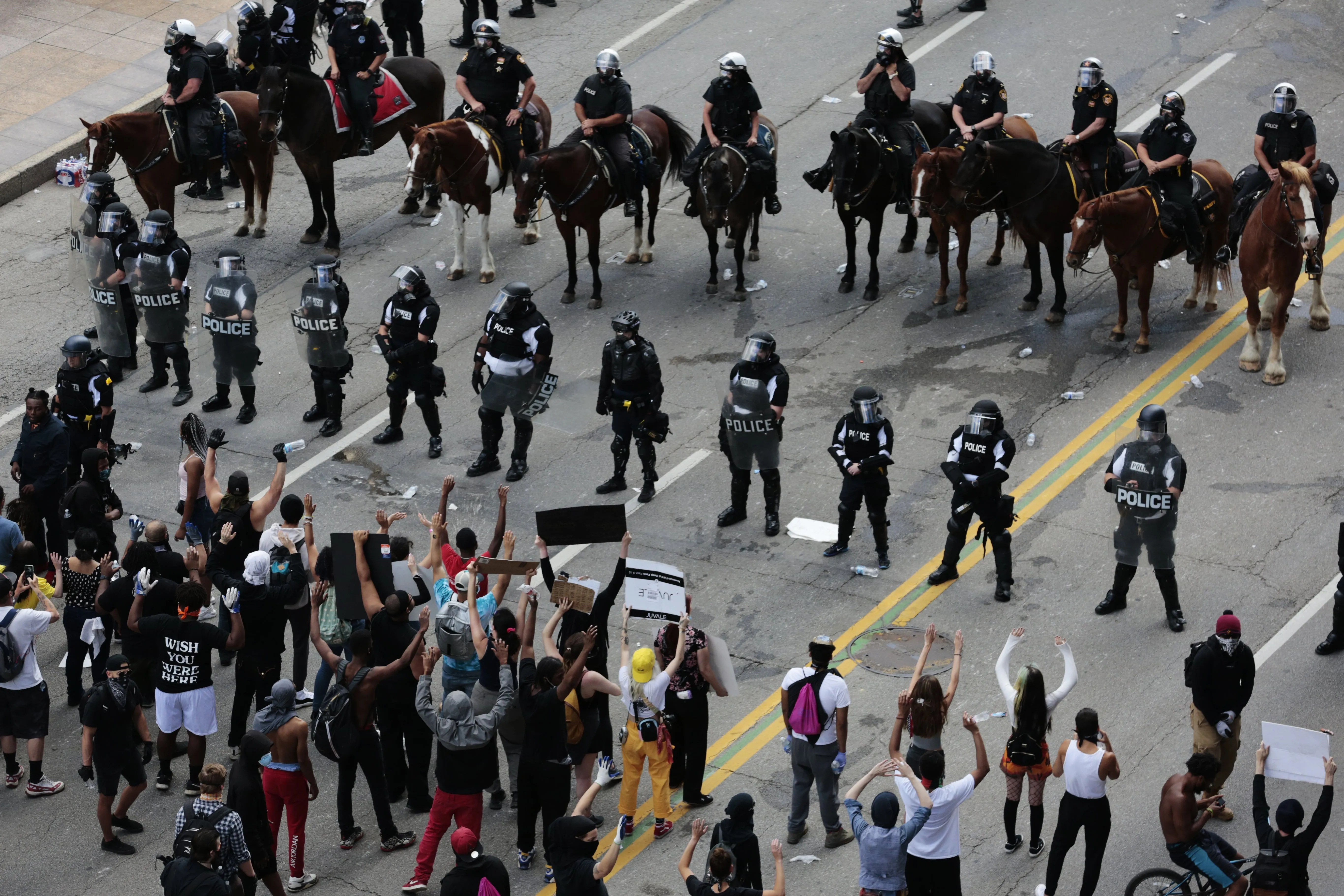 Peaceful demonstrators stand in the middle of Broad Street as Columbus Division of Police officers attempt to move them from the area during protests following the death of Minneapolis man George Floyd on Saturday, May 30, 2020 in Columbus, Ohio.