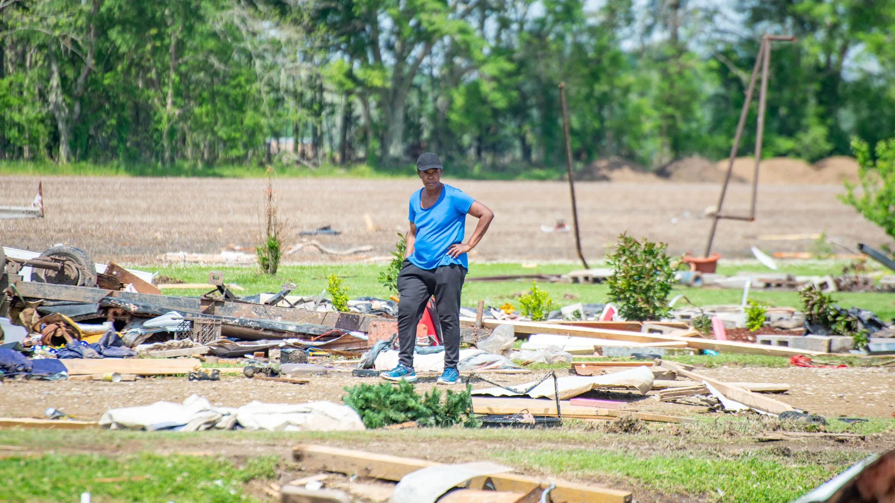 Gladus Johnson studies the damage caused by a deadly tornado in the parish of St. Landry.