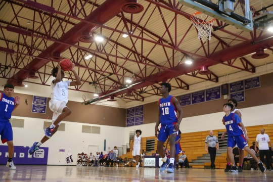 Cesar Chavez' TyQuan Solomon (2) takes a shot against North during a game in Phoenix April 19, 2021.