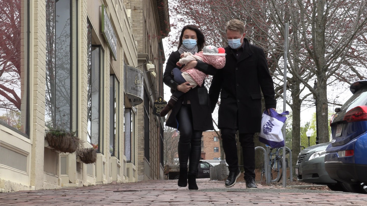Thomas Feldborg and wife Daria Rokina carry their daughter Alissa Rokina Feldborg, 16 months old, home from physical therapy on April 13, 2021 in Arlington, Mass.
