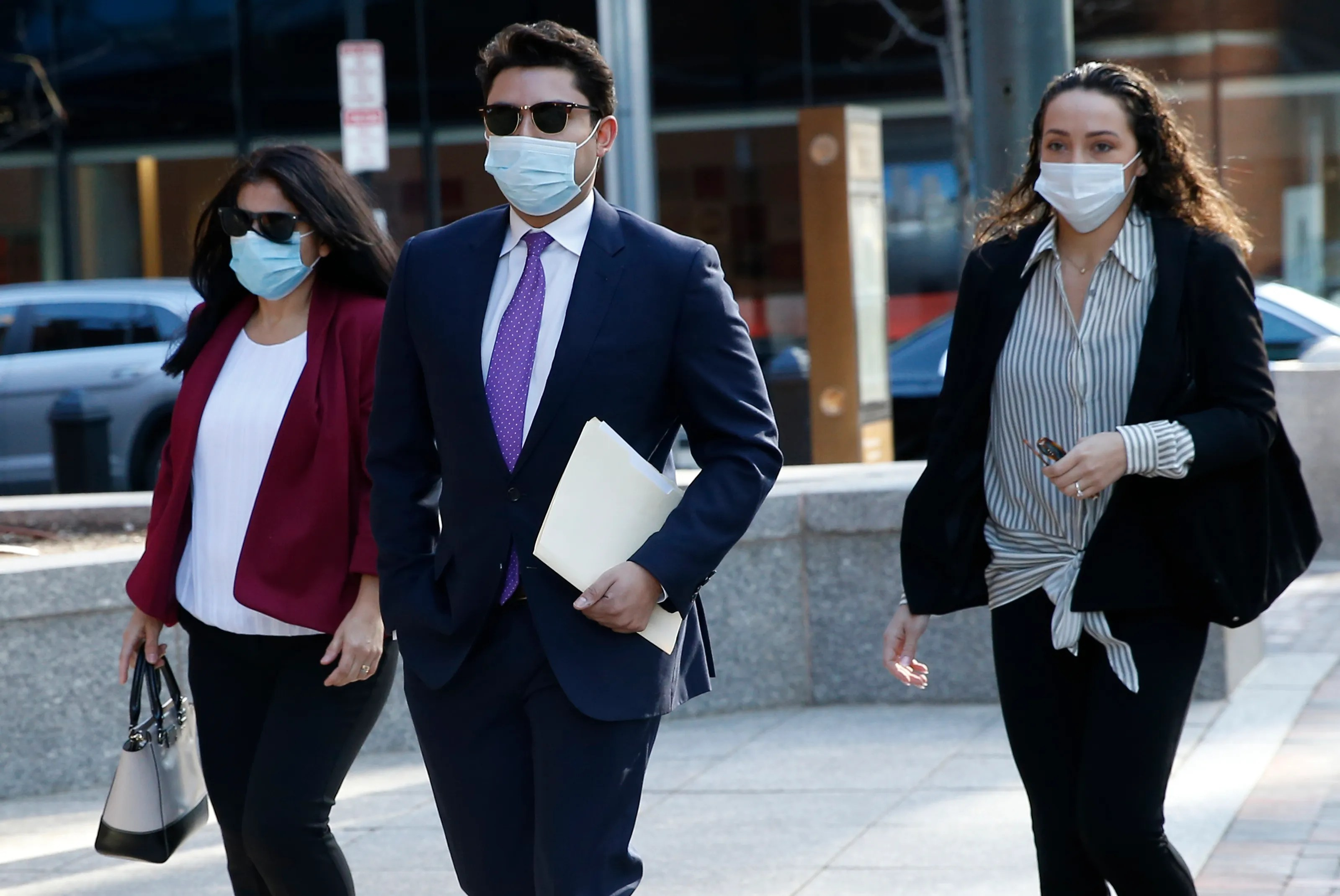 Former Fall River Mayor Jasiel Correia, center, arrives to the John Joseph Moakley United States Courthouse, Monday, April 26, 2021, in Boston. Opening statements in Correia's federal corruption trial began Monday.