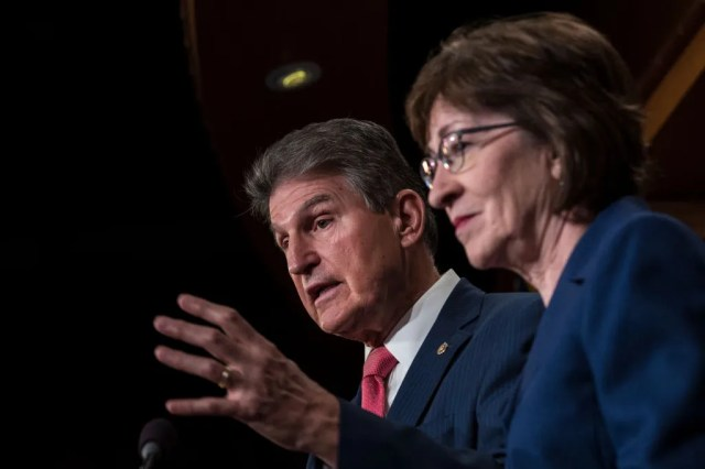 Sen. Joe Manchin and Sen. Susan Collins speak during a press conference on Capitol Hill in 2018.