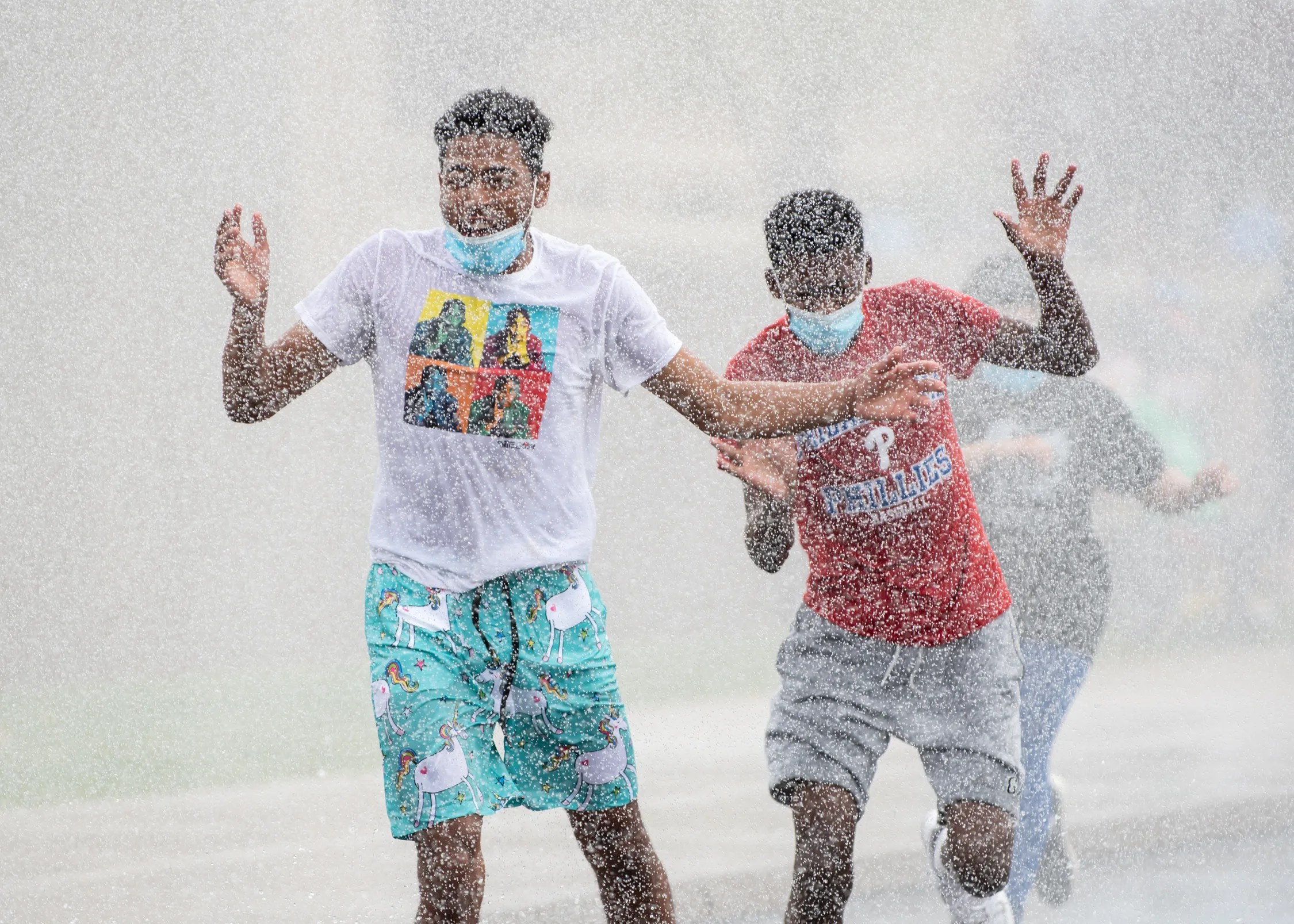 Students, teachers and staff, splash their way through a spray of water during Pennridge High School's April Showers event, a fundraiser supporting Special Olympics athletes and the school's unified sports teams, at Pennridge High School on Thursday, April 29, 2021.