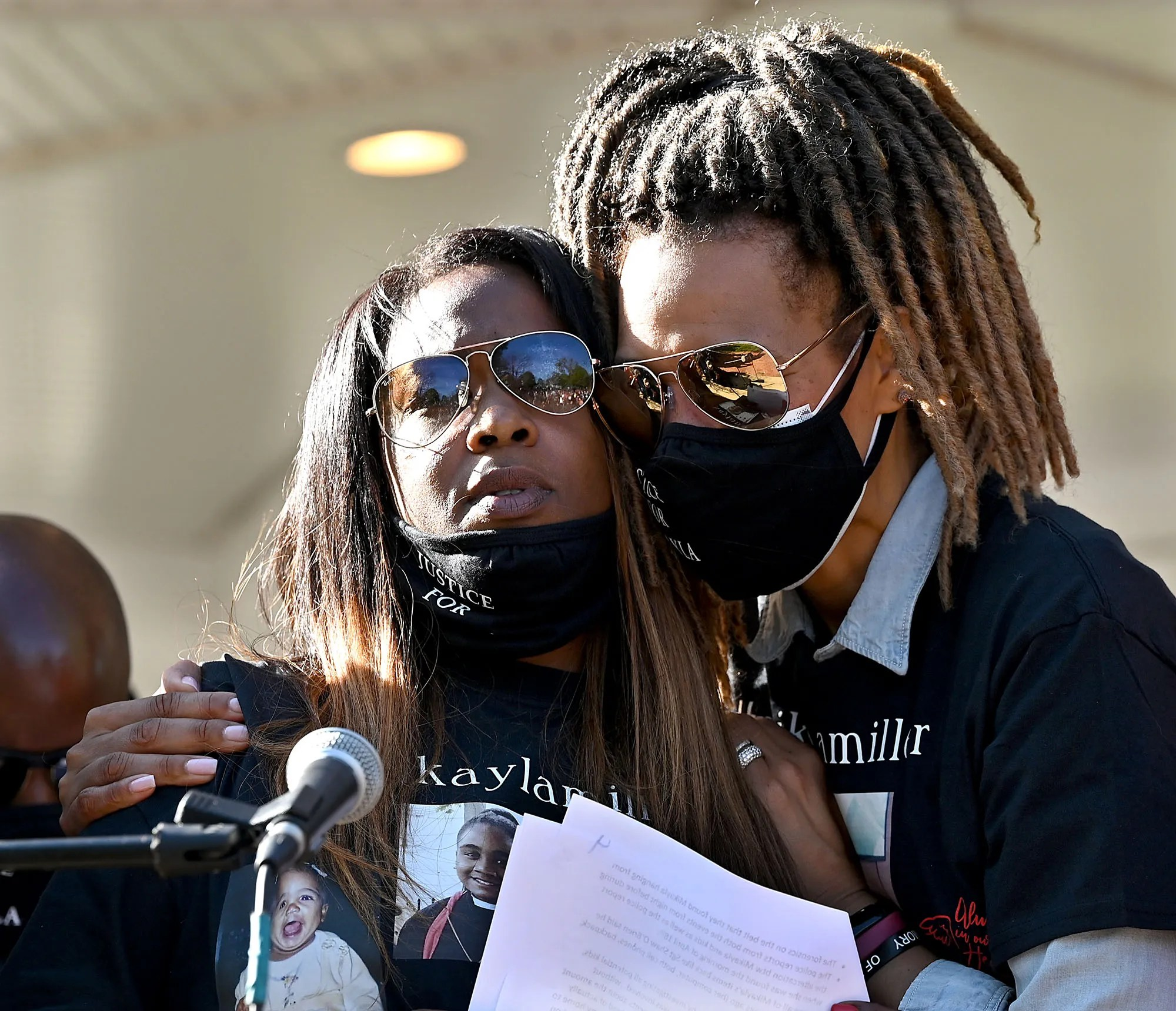 Calvina Strothers of Hopkinton,  left, the mother of Mikayla Miller, is comforted by Angela Clark, a cousin, during a rally on Hopkinton Common  drawing attention to the investigation into the Hopkinton sophomore's death, on May 6, 2021. Miller, 16, was found dead in the woods near her Hopkinton home April 18.