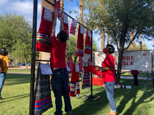 The Red Dress Project Display put up by the Phoenix Indian Center put the names of missing and murdered Indigenous people on symbolic red skirts.