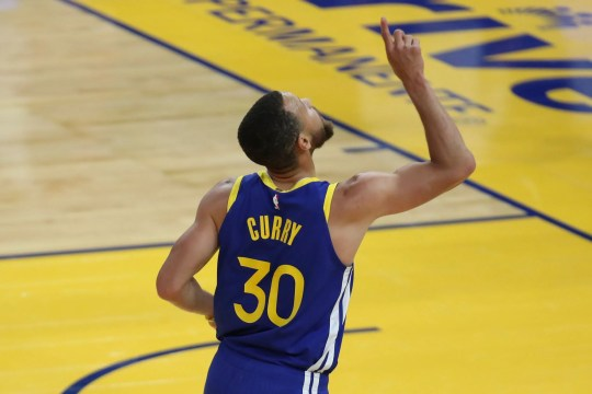 Golden State Warriors' Stephen Curry points to the sky after scoring against the Oklahoma City Thunder during the first half of an NBA basketball game in San Francisco, Saturday, May 8, 2021. (AP Photo/Jed Jacobsohn)