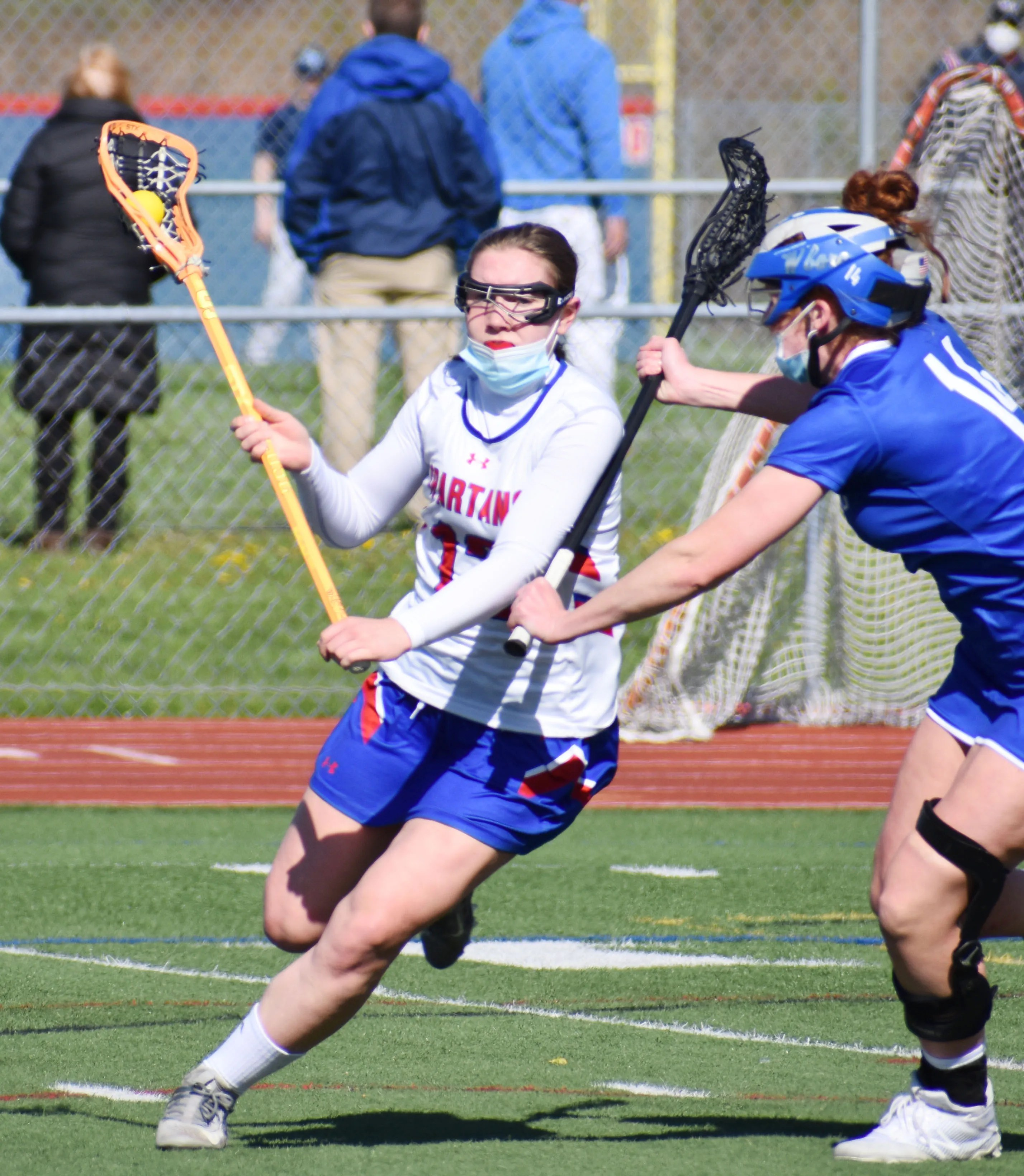 New Hartford's Maia Herring, left, makes a move against a Whitesboro player on Tuesday at Don Edick Field in New Hartford. Herring had three goals in New Hartford's 11-6 win.