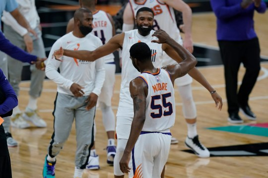 Phoenix Suns guard E'Twaun Moore (55) celebrates with teammates after his winning score against the San Antonio Spurs during the second half of an NBA basketball game against the San Antonio Spurs in San Antonio, Sunday, May 16, 2021. (AP Photo/Eric Gay).