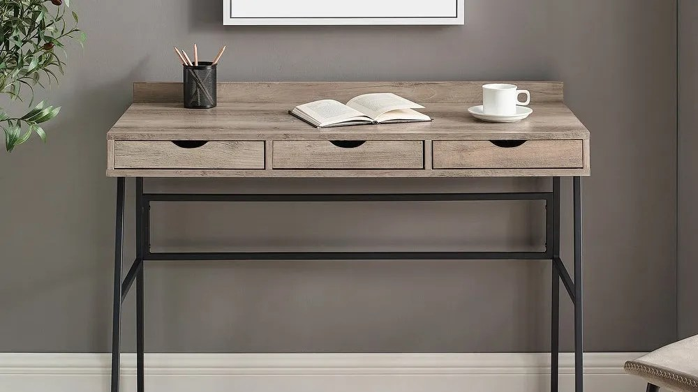 At a comfortable 42-inch length, this Carbon Loft writing desk can fit into most home offices.