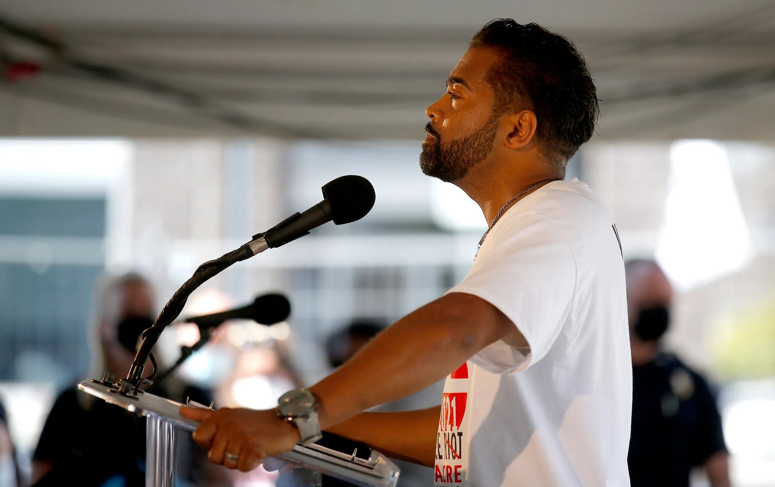 """Phil Amstrong sings """"Lift Every Voice and Sing"""" during the Aug. 21, 2020, groundbreaking event for Greenwood Rising: The Black Wall Street History Center, hosted by the 1921 Tulsa Race Massacre Centennial Commission, in the Greenwood District of Tulsa."""