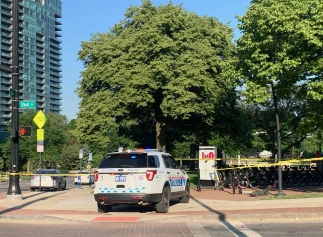 Crime scene tape surrounds Bicentennial Park in downtown Columbus on Sunday, May 23, 2021, as Columbus police investigate a mass shooting late Saturday night in which a 16-year-old girl was killed and five other teens were wounded.
