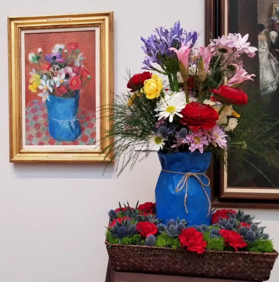 From 2018: William James Glackens, Bouquet in Blue Paper-Wrapped Pot. Interpreted by the Hagerstown Garden Club: Betsy Hardinge, Jennifer Thomas, Margaret Waltersdorf