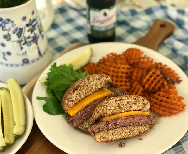 This Wisconsin-themed cookout plate includes a prime rib burger from Ney's Premium Meats in Hartford, topped with a sharp cheddar from Hook's Cheese in Mineral Point on a sprouted whole grain bun from Angelic Bakehouse in Cudahy.