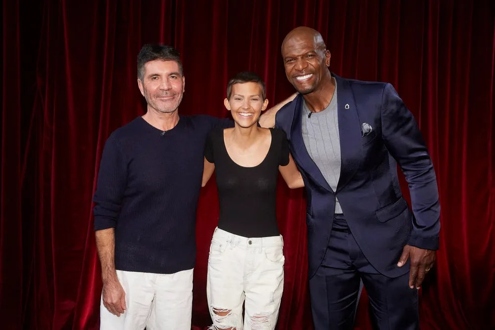 Zanesville native Jane Marczewski, who goes by Nightbirde when she sings, with judge Simon Cowell (left) and host Terry Crews (right) after she received the golden ticket to the live show at her America's Got Talent audition, broadcast on Tuesday night.