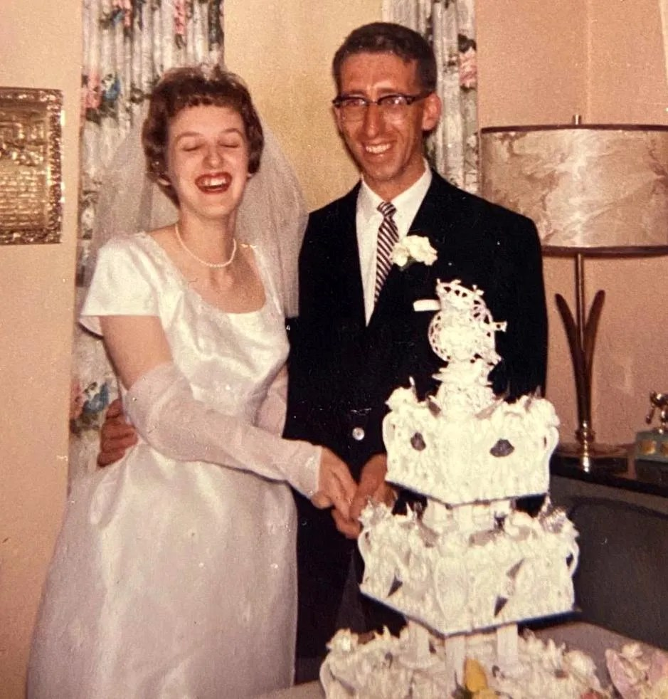 Jean stands in front of her wedding cake with her husband, Ernie, on their wedding day, June 17, 1961.