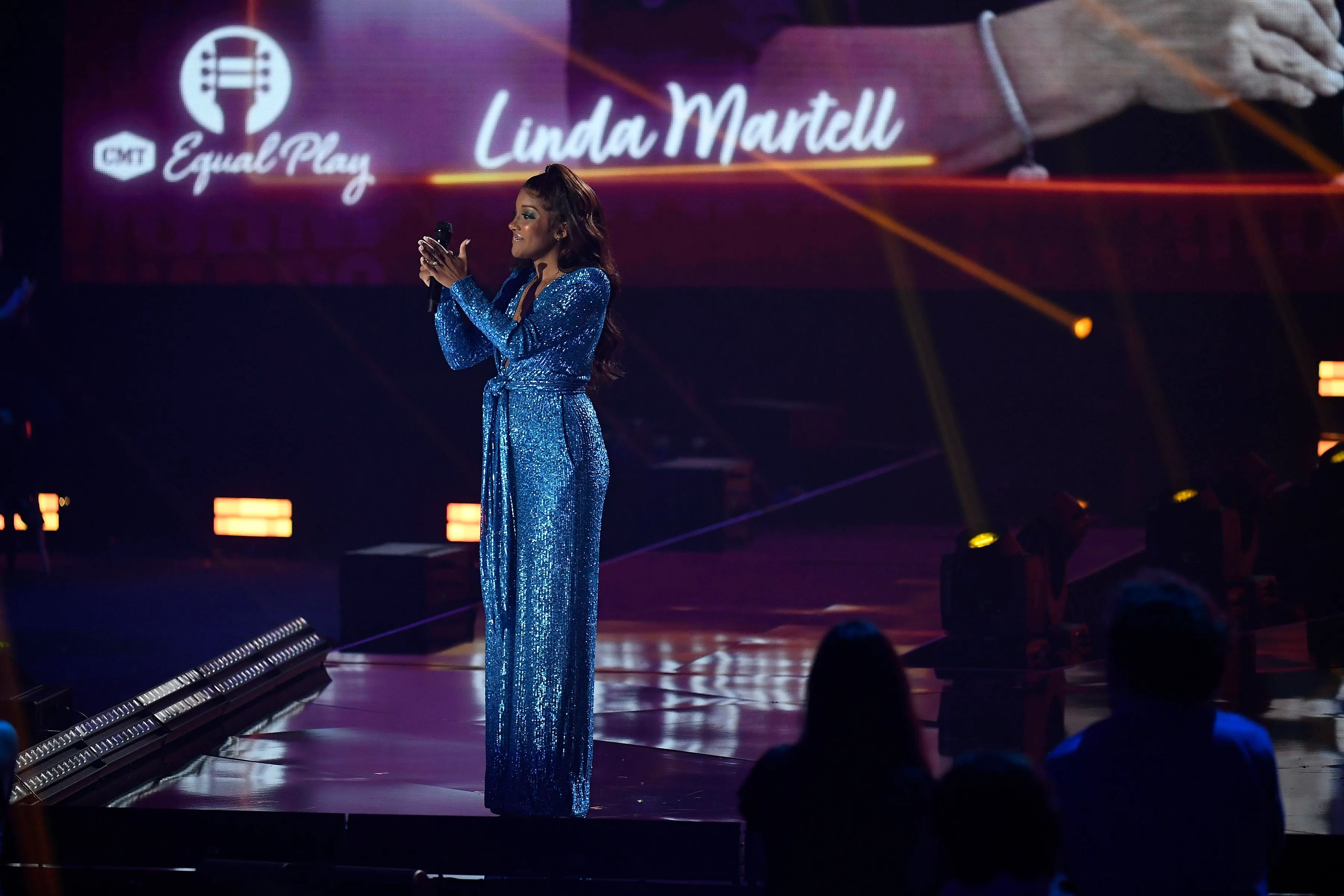 Mickey Guyton presents the Equal Play Award to Linda Martell during the 2021 CMT Music Awards at Bridgstone Arena in Nashville, Tenn on Wednesday, June 9, 2021.