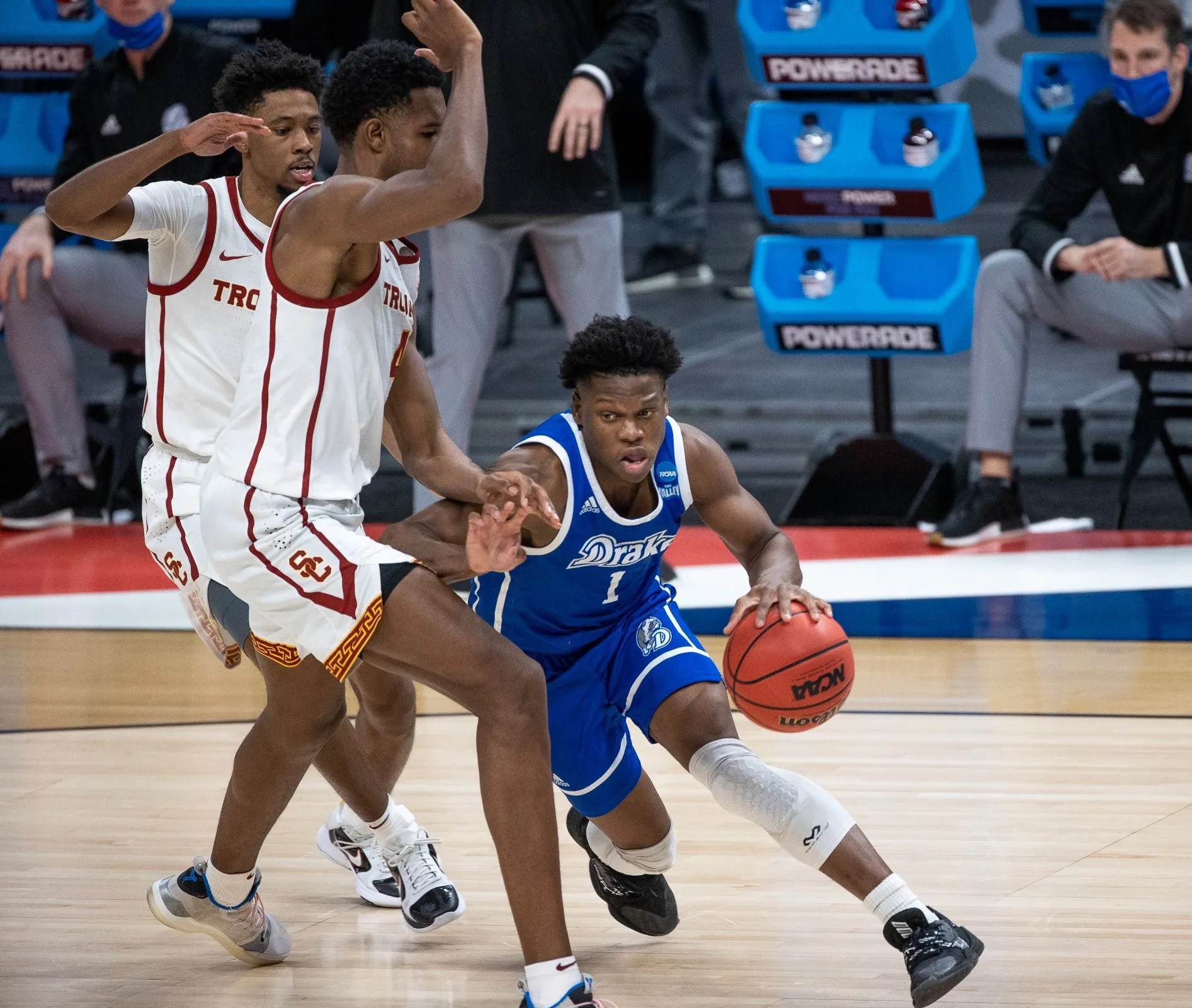 Kansas guard Joseph Yesufu (1), a transfer from Drake, drives on USC forward Evan Mobley (4) during the first round of the 2021 NCAA Tournament .