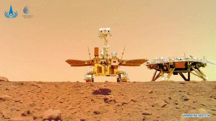 China's rover Zhurong (center) explores the Martian surface in a new photo released June 11, 2021.