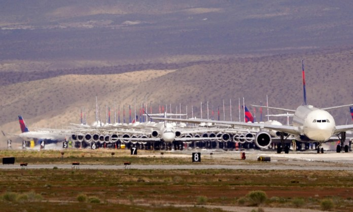 Delta Airlines aircraft are stored at Southern California Logistics Airport, Wednesday, March 25, 2020, in Victorville, Calif.