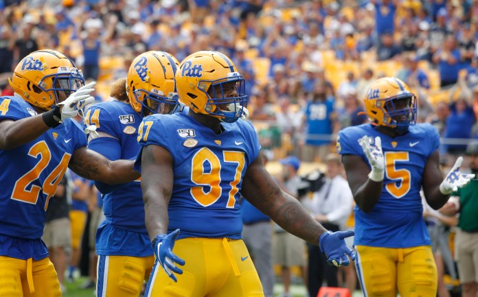 Pittsburgh Panthers defensive lineman Jaylen Twyman (97) celebrates a defensive stop against the Ohio Bobcats during a 2019 game at Heinz Field.