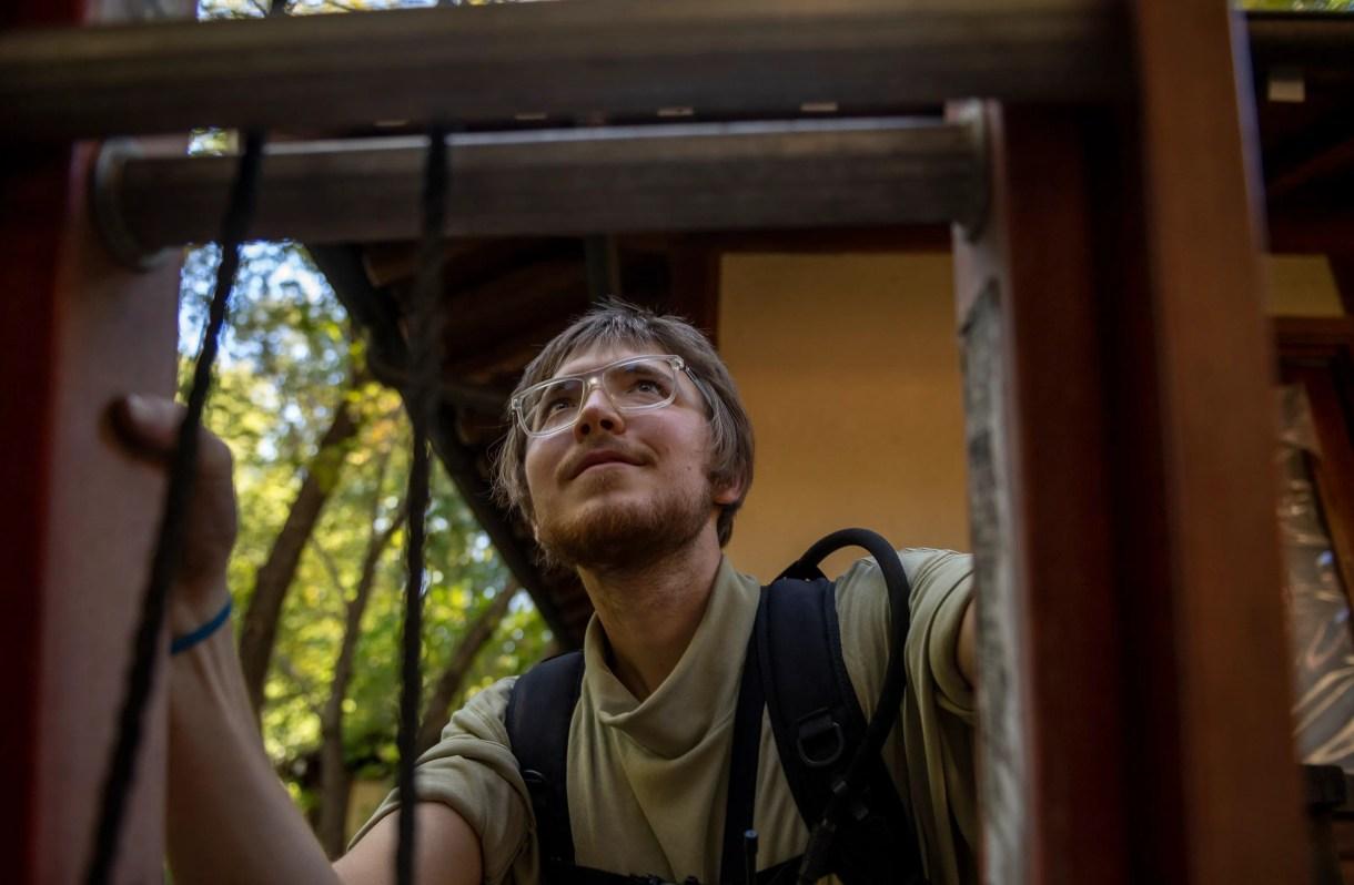 Finnian Kelley, a member of the Tassajara Fire Crew, began climbing a ladder to secure the sprinkler head on the roof of the Tassajara Zen Mountain Center in Carmel Valley, California on Thursday, June 24, 2021.