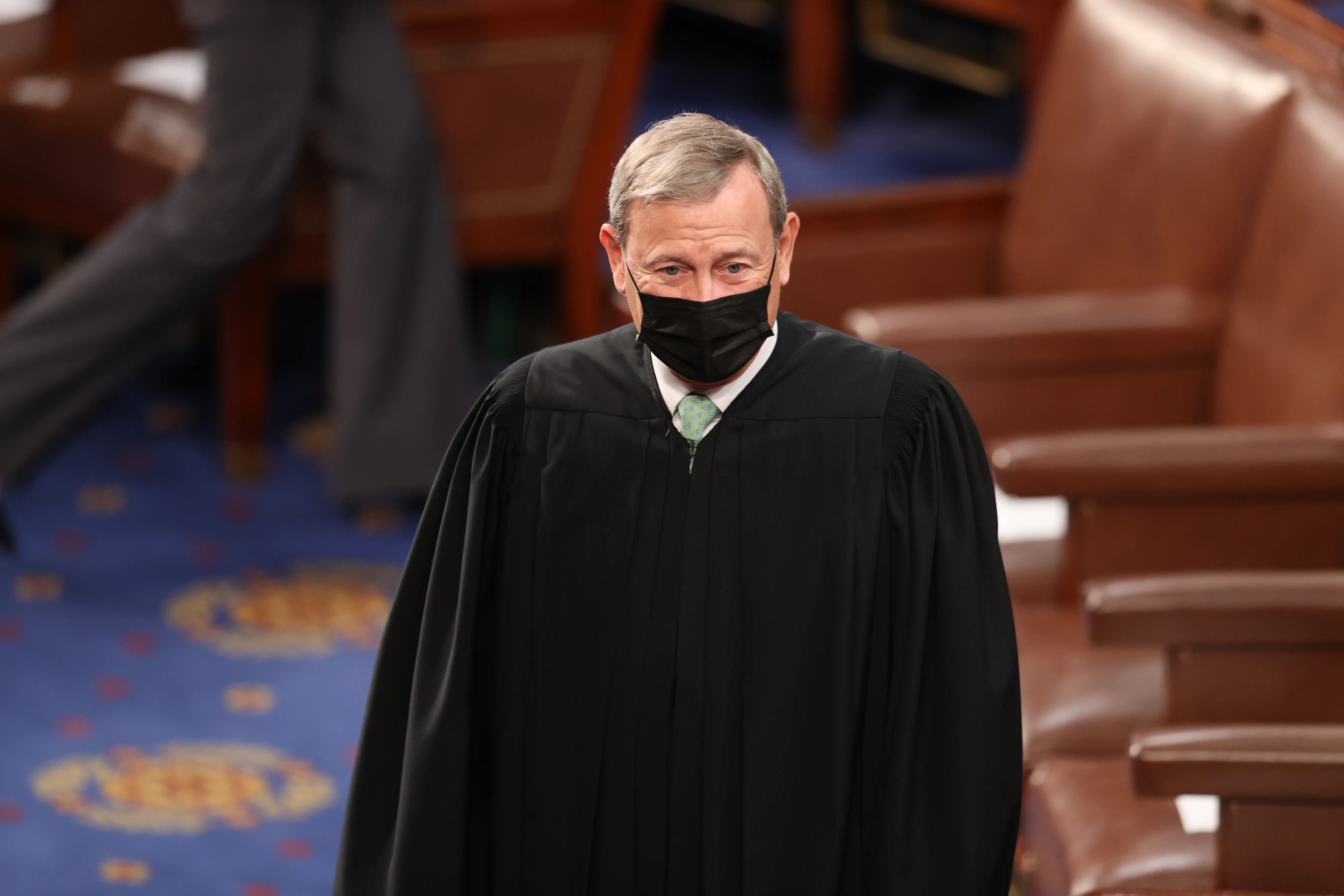 Supreme Court observers said Chief Justice John Roberts tried to keep partisan temperatures low.