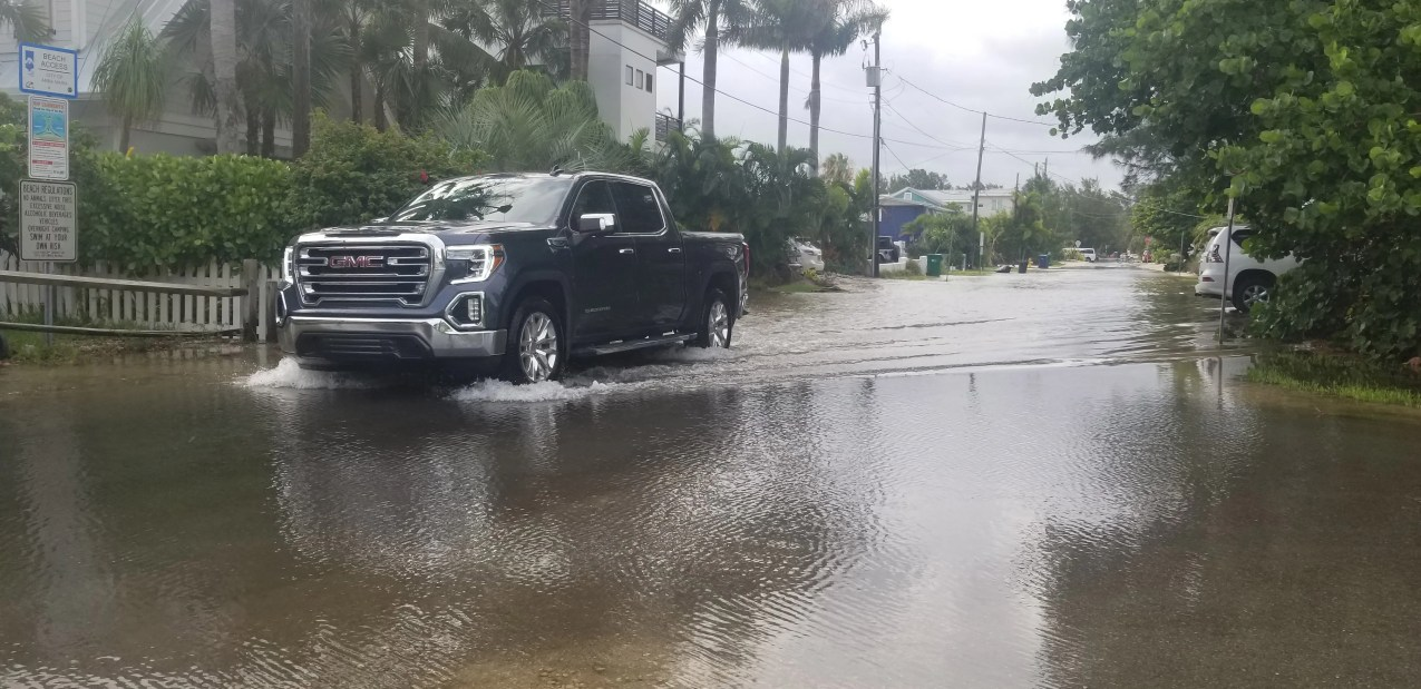 A truck drives through floodwater on North Shore Drive, on Anna Maria Island, on July 7, 2021. Tropical Storm Elsa caused street flooding on the island in Manatee County.