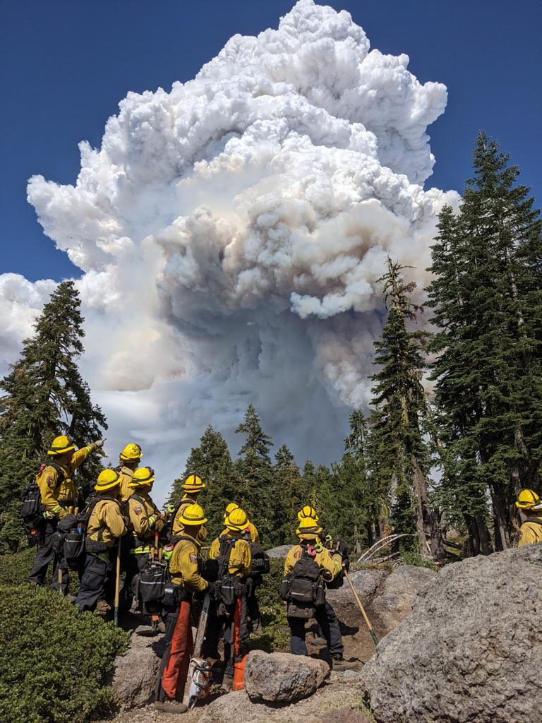 Cal Fire's Santa Clara unit strike team 9163G stands in the foreground of the Dixie Fire on Tuesday (July 20, 2021).