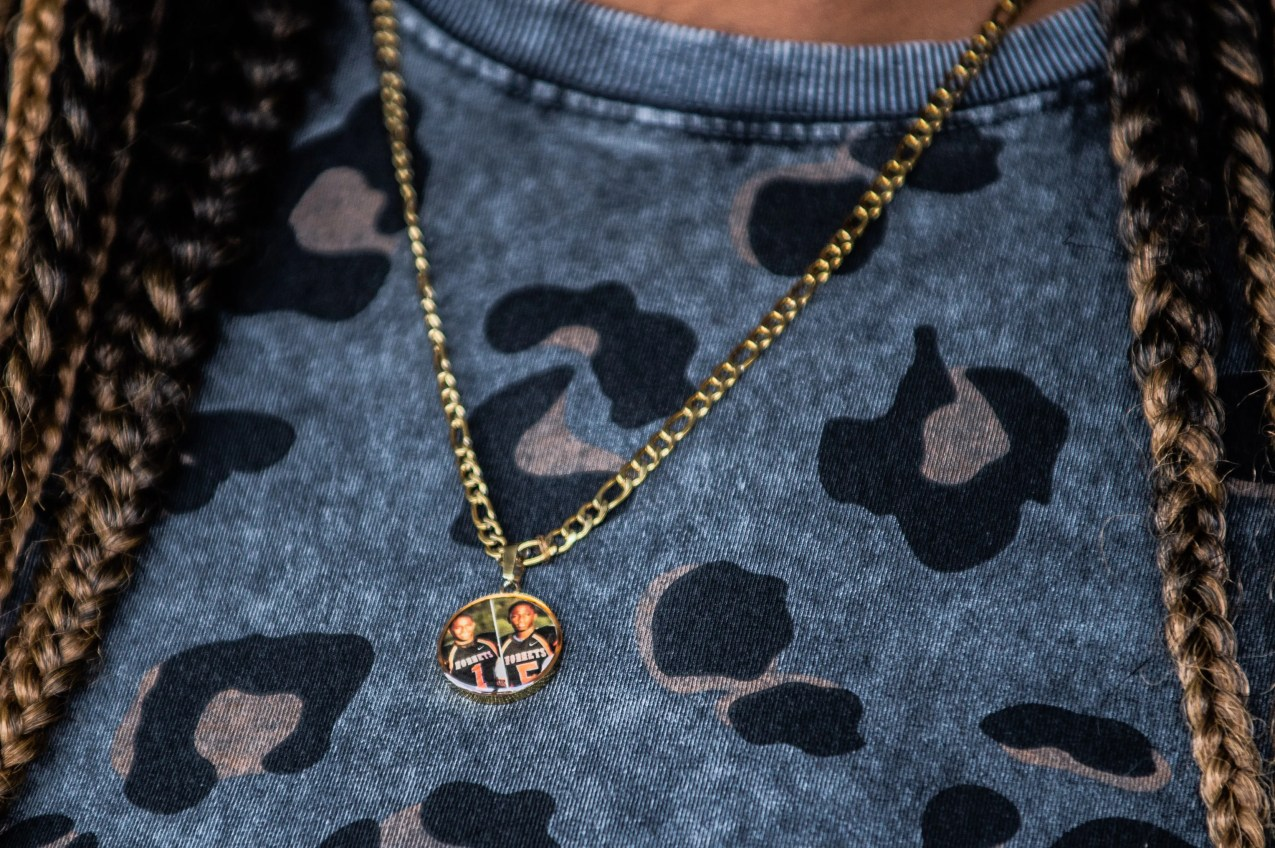 Dorena Collier, co-owner of One Five Bar and Grill, wears a necklace everyday with the picture of her twin sons, KeyshawnandShawn Collier,who passed awayonApril 12, 2015.