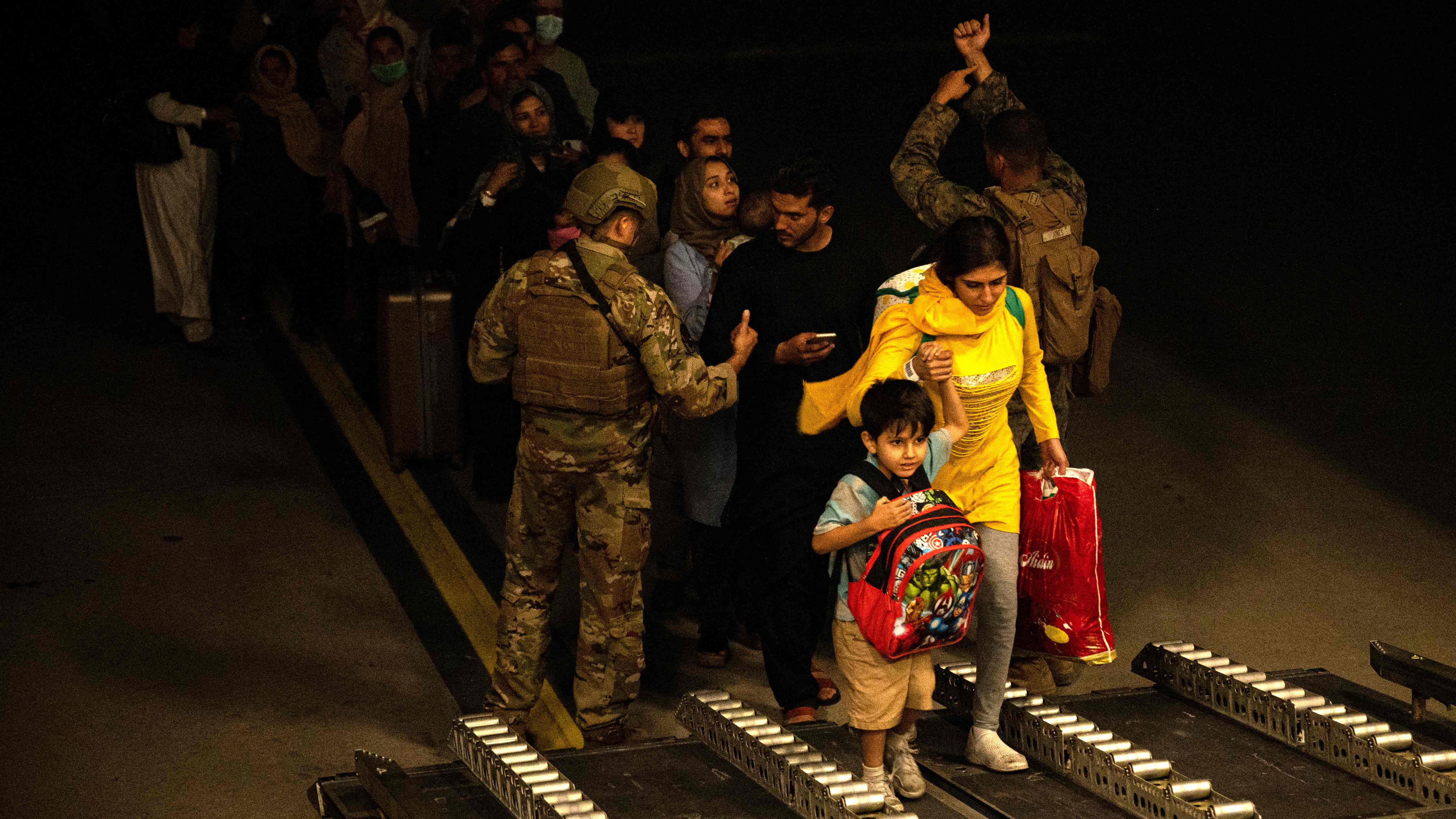 Afghans civilians are evacuated by the US military on Aug. 19, 2021 at an undisclosed location. US evacuation operations from Kabul's airport slowed Friday because the receiving base in Qatar was overflowing and could not receive evacuees.